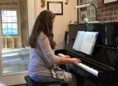 Ashley playing her arrangement