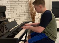 Lucas playing Minuet by JC Bach
